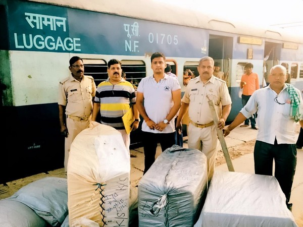 Police with illegal cache at the Charbagh station on Saturday. Photo/ANI