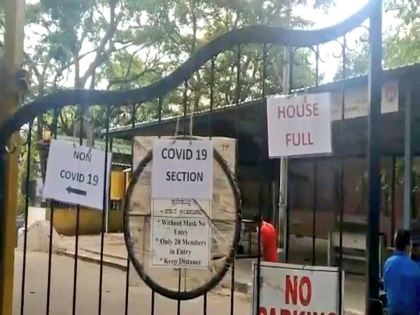 'Housefull' board displayed outside the Chamrajpet Crematorium gate. (Photo/ANI)