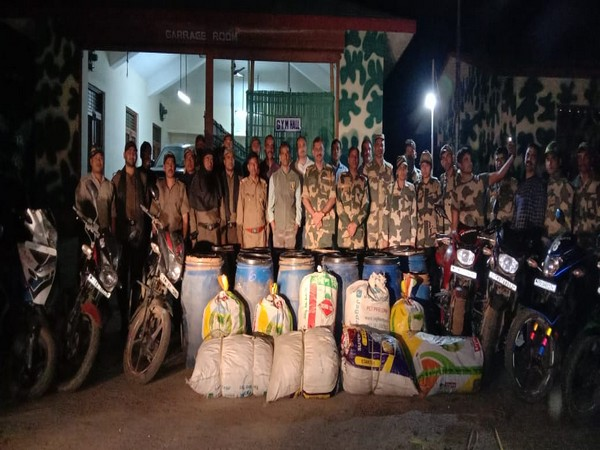 The team of 74 Battalion of BSF with the seized ganja and motorcycles. Photo/ANI