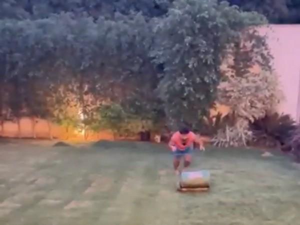 Rishabh Pant mows the lawn at home. (Photo/ Rishabh Pant twitter grab)