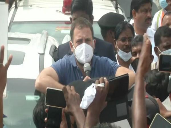 Rahul Gandhi addressing a gathering during his roadshow in Perundurai on Sunday. Photo/ANI
