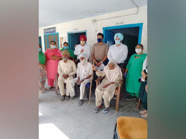 Centenarian Jattan Kaur, 105 at a vaccination camp.