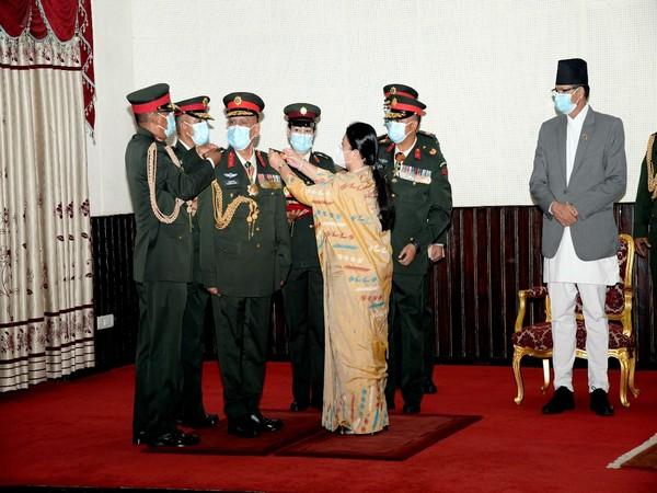 Nepal President Bidhya Devi Bhandari conferred the insignia of the army staff to General Sharma.