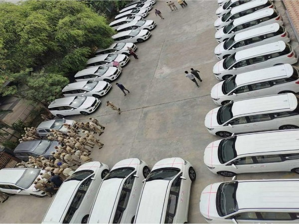 32 brand new Kia Carnival MUVs at the Pragati Bhavan. (Photo/ANI)