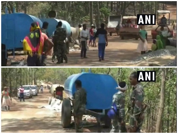 Construction of road underway in Naxal-affected area under CRPF and police security in Balrampur.