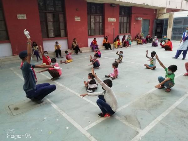Children at a shelter home sitauted in Rajkiya Pratibha Vikas Vidyalaya, Ashoka Pahari, Delhi doing exercise on Saturday [Photo/ANI]