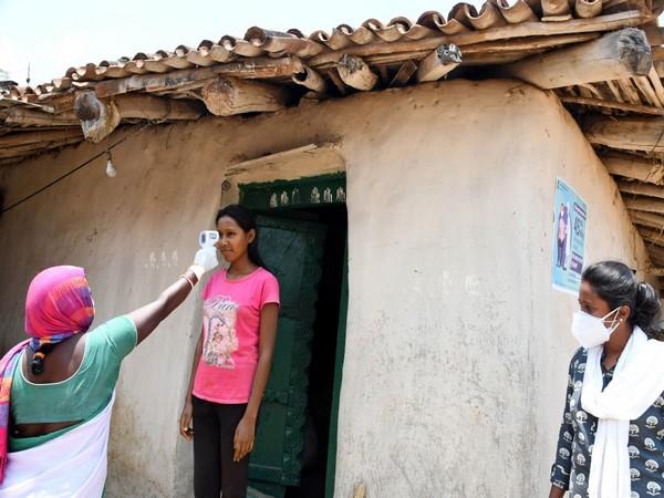 A health worker measuring the temperature of a girl at Sarang Panchayat near Turup village in Ranchi on May 22. (Photo/ANI)