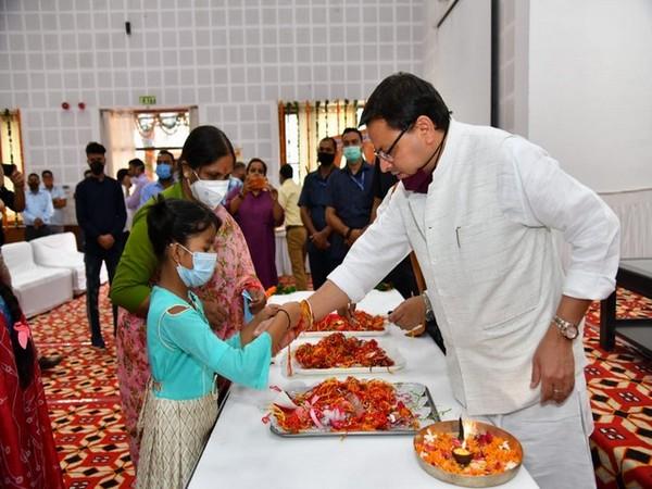 Uttarakhand CM Pushkar Singh Dhami celebrating Raksha Bandhan with members of Nari Niketan. (Photos/ANI)