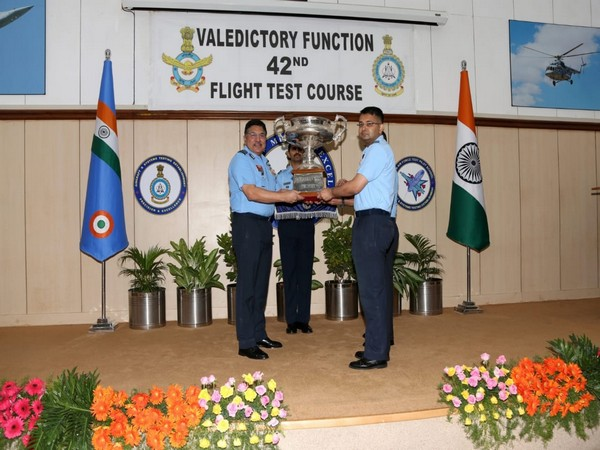 Air Marshal AS Butola, Air Officer Commanding-in-Chief, Training Command, felicitating a graduate in Bengaluru on Friday.