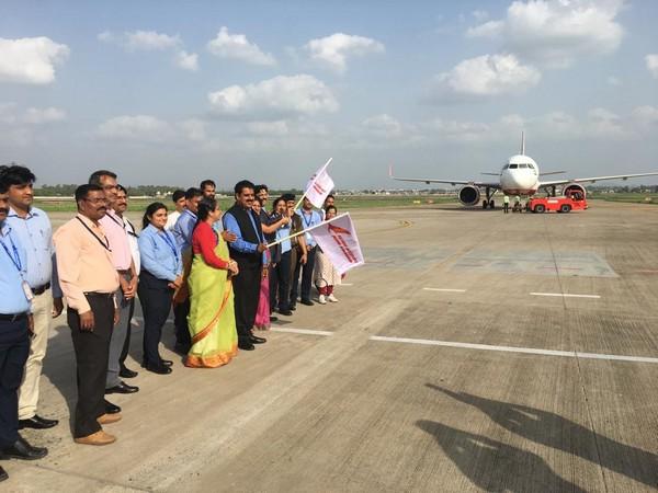 BJP MP Shankar Lalwani flagging off the Indore-Dubai flight at Indore airport on Monday. (Photo/ANI)
