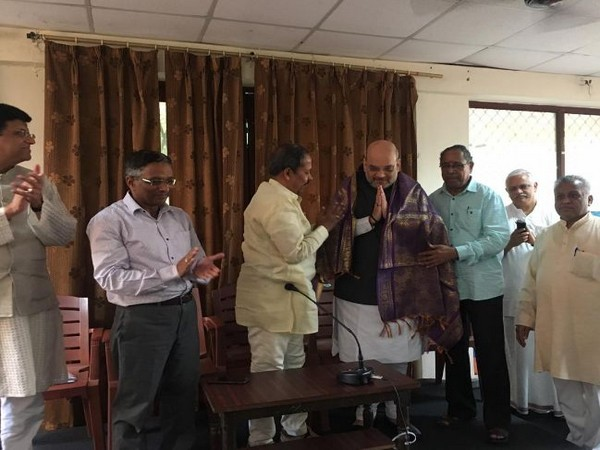 BJP national president and Union Home Minister Amit Shah being felicitated at BMS headquarters in New Delhi. Photo/ANI