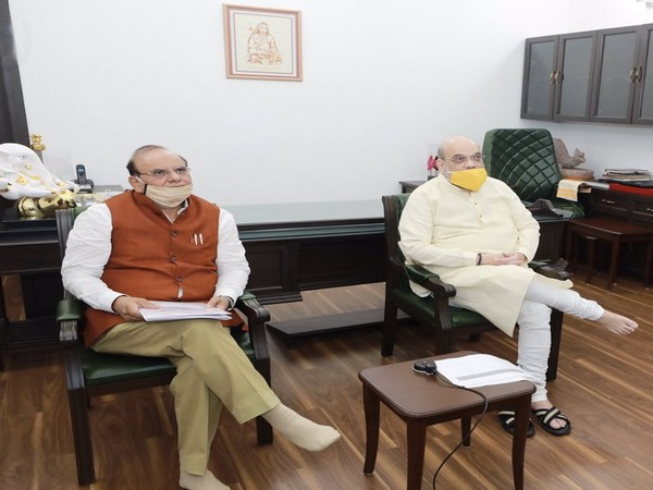 Union Home Minister Amit Shah with KVIC Chairman Vinai Kumar Saxena interacting with potters via video conferencing