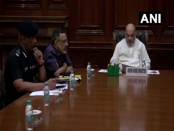 Union Home Minister Amit Shah while conducting high-level meeting to review current flood situation on Saturday in New Delhi. Photo/ANI