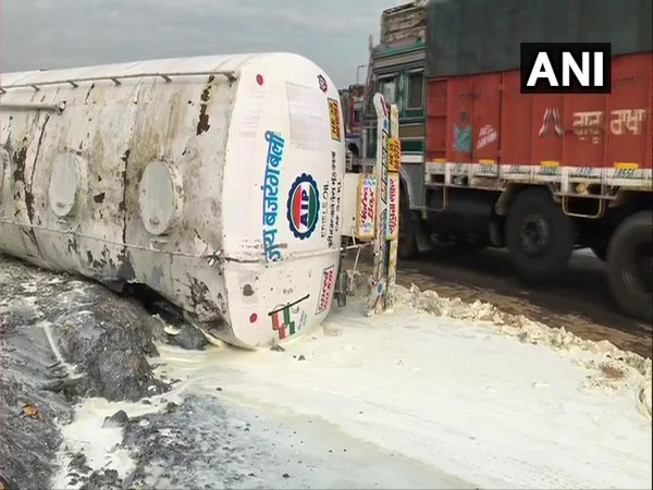 A tanker truck, carrying ingredients to make soap, overturns in West Bengal (Photo ANI)