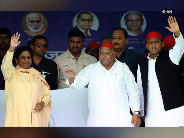 BSP chief Mayawati and SP leaders Mulayam and Akhilesh Yadav waving to the people at a rally here on Friday. Photo/ANI