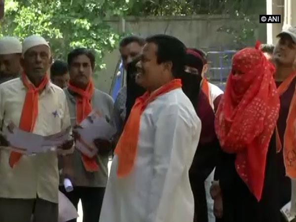 Muslims BJP workers seeking voters in Jamalpur Darwaza of Ahmedabad West constituency on Saturday. Photo/ANI