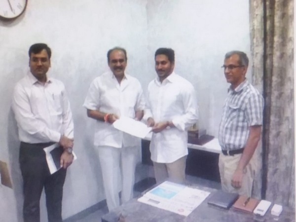 State Power Minister Balineni Srinivas Reddy handing over the cheque to Chief Minister YS Jaganmohan Reddy at his camp office in Tadepalli, Amaravati on Tuesday.