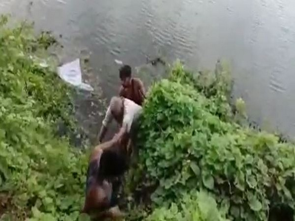 Man rescued after being slipped near Kanigiri Reservoir Canal in Nellore in Andhra Pradesh on Friday. Photo/ANI