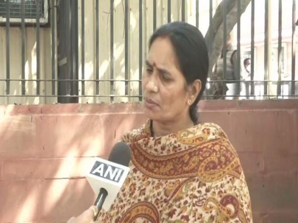 ASHA worker (Blue saree) giving sanitary napkins to a woman in Puri, Odisha.
