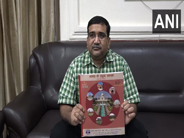 ASI Superintendent Basant holding the book (Photo/ANI)