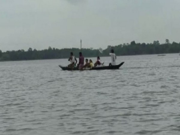 Visuals of villagers shifting to safe places due to flood in Assam on Saturday. Photo/ANI