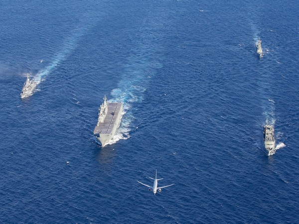 (L-R) HMAS Ships Parramatta, Canberra, Newcastle and Success in formation with a P-8A Poseidon and a MH60-R Maritime Combat Helicopter off W. Australia coast during Indo-Pacific Endeavour 2019