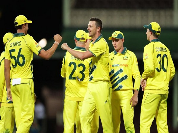 Australian team celebrating after taking 1-0 lead in the three-match ODI series. (Photo/ICC Twitter)