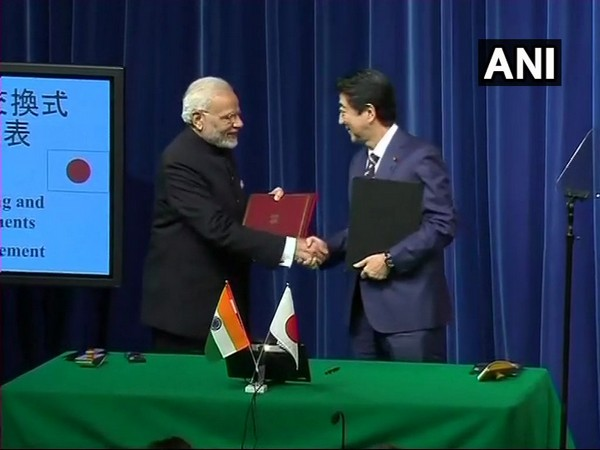 Prime Minister Narendra Modi while shaking hands with his Japanese counterpart Shinzo Abe during 2018 October meeting in Tokyo. (Photo: ANI)
