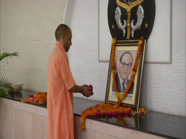 UP Chief Minister Yogi Adityanath on Tuesday paid floral tribute to Dr Bhimrao Ambedkar in Lucknow.