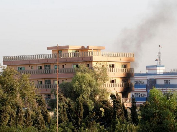 Smoke billowing out of government building following a Taliban attack on Wednesday