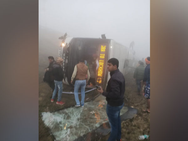 The bus which rolled over on Agra-Lucknow Expressway near Fatehabad in Agra district on Monday morning. Photo/ANI