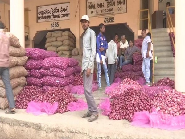 Wholesale traders at the Agricultural Produce Market Committee, Gujarat on Thursday