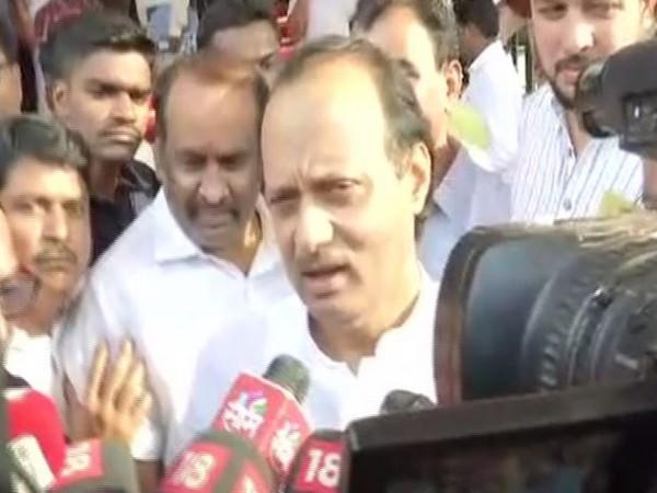 NCP leader Ajit Pawar speaking to reporters in Mumbai on Saturday.