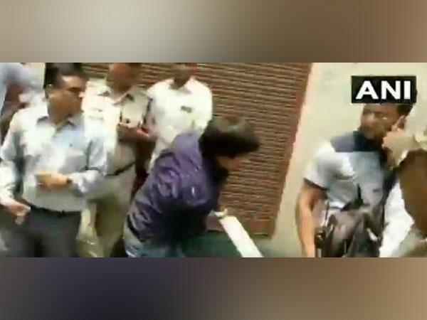 Akash Vijayvargiya trashing a Municipal Corporation officer with a bat in Indore. (File Photo: ANI)