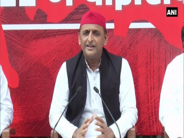 Samajwadi Party leader Akhilesh Yadav speaking with reporters in Etawah, Uttar Pradesh.
