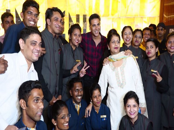 Akshay Kumar posing with fans after the film screening