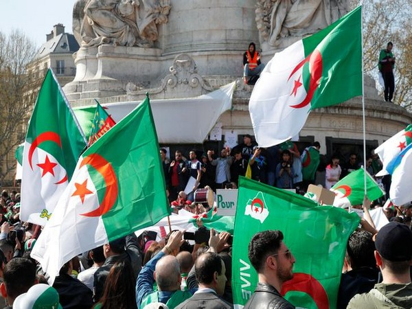 Protesters carrying Algerian flags demand the removal of key officials from former Abdelaziz Bouteflika's regime in Algiers on Friday.