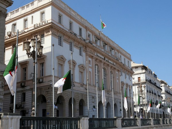Algerian flags fly at half mast outside the Council of the Nation in Algiers. (Photo Credit - Reuters)
