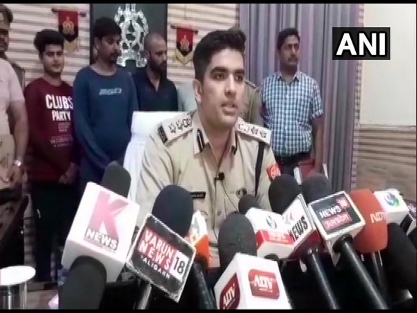 SSP Aligarh Akash Kulhari speaking with reporters on Wednesday. Photo/ANI