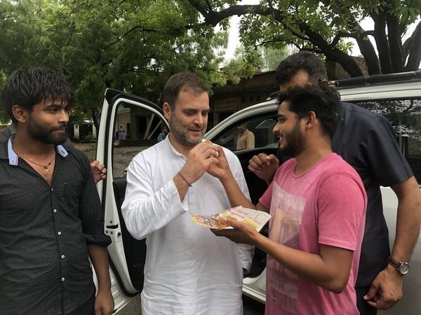 Rahul Gandhi eats 'jalebis' in Amethi on Wednesday. Photo/ANI
