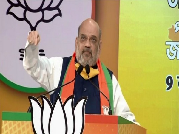 Union Home Minister and BJP leader Amit Shah speaking at the West Bengal Jan Samvad Rally on Tuesday. (Photo/ANI)