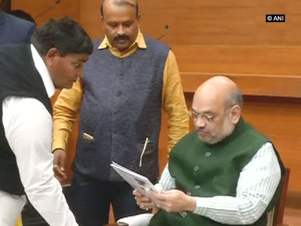 BJP president Amit Shah accepting bio-data from a ticket seeker at the party headquarters in New Delhi on Thursday. Photo/ANI