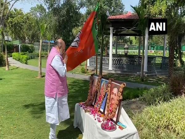 Union Home Minister Amit Shah pays floral tribute to Syama Prasad Mukherjee and Pt Deendayal Upadhyaya.