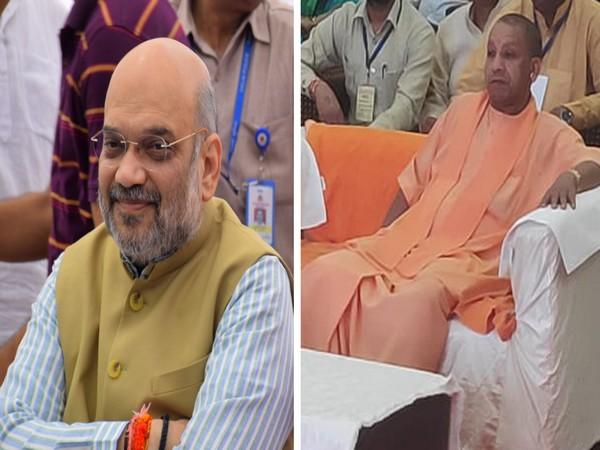 Amit Shah (L) and Yogi Adityanath (R) listen to Mann Ki Baat