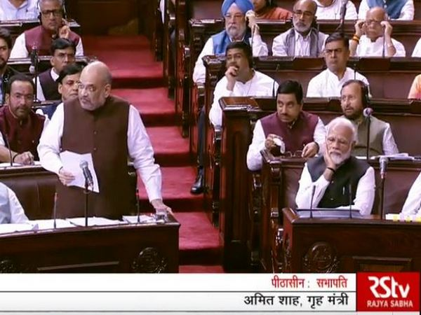 Home Minister Amit Shah during his address in parliament on Monday. (Pic courtesy: RS TV)