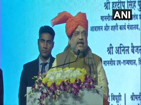 Home Minister Amit Shah addressing an event in Delhi on Monday. =