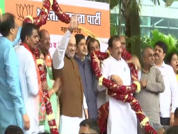 Home Minister Amit Shah welcomed by BJP workers at the Mumbai Airport on his arrival on Monday. Photo/ANI