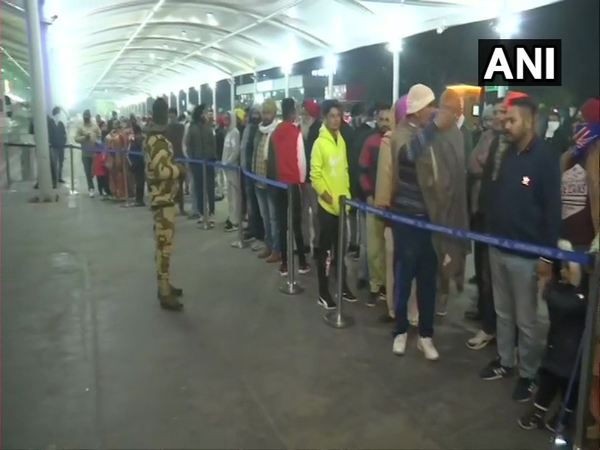 Passengers arriving from the UK Amritsar are waiting in a long queue to get themselves tested for COVID-19 in the wake of the new virus coronavirus strain.