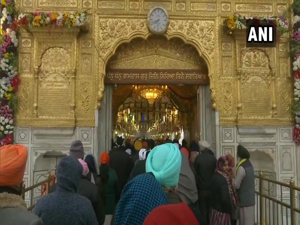 People offer prayers at the Golden Temple on the occasion of Prakash Purab.