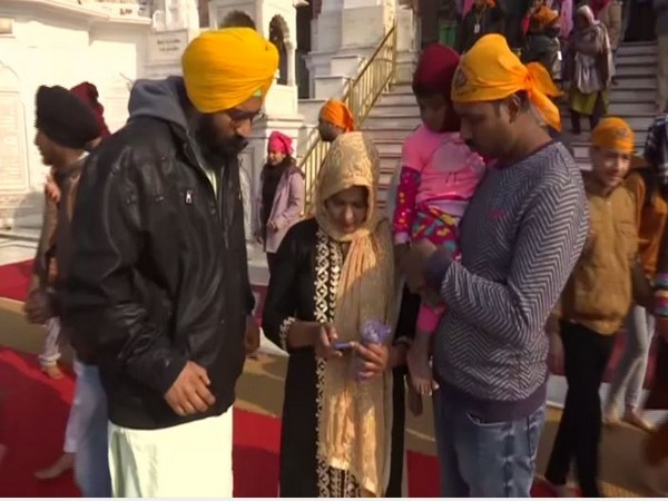 A volunteer asks visitors to delete the videos and pictures taken inside Golden Temple premises from their devices. Photo/ANI